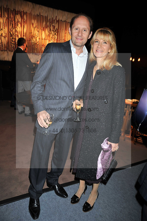 MR & MRS BERTRAND SCHWAB at the Moet Hennessy Pavilion of Art & Design London Prize 2009 held in Berkeley Square, London on 12th October 2009.