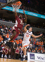 Florida State forward Chris Singleton (31) skies for a layup past Virginia guard Sammy Zeglinski (13).  The Virginia Cavaliers fell to the Florida State Seminoles 73-62 in NCAA Basketball at the John Paul Jones Arena on the Grounds of the University of Virginia in Charlottesville, VA on January 24, 2009.