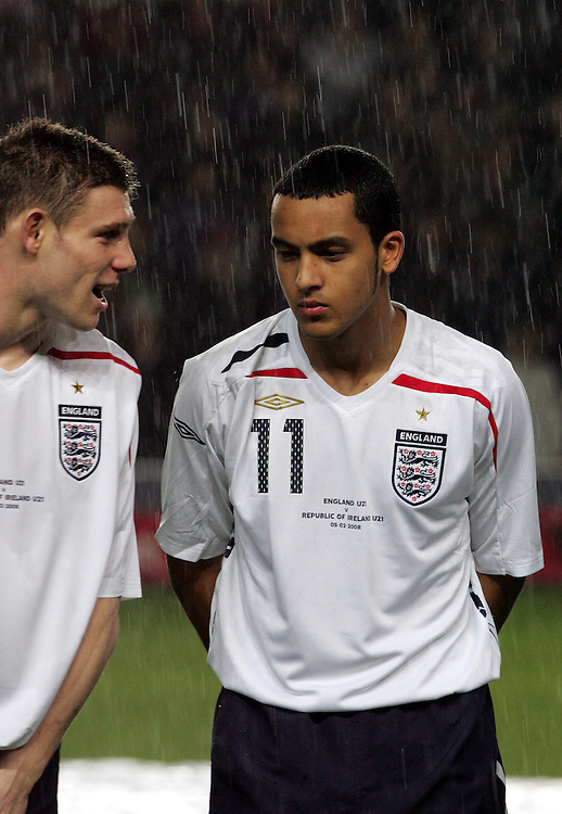 James Milner chats with Theo Walcott in the heavy rain before the game. England v Republic of Ireland, Uefa Under-21 Championship Qualifier, Tuesday 5th February 2008, St Marys, Southampton.