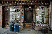 The facade of an old store on Van Brunt Street in Red Hook, Brooklyn