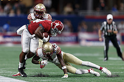 Alabama Crimson Tide running back Damien Harris (34) is tackled by Florida State Seminoles defensive back Tarvarus McFadden (4) during the Chick-fil-A Kickoff NCAA football game on Saturday, September 2, 2017, in Atlanta. (Paul Abell via Abell Images for Chick-fil-A Kickoff Game)
