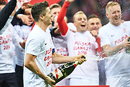 Warsaw, Poland - 2017 October 08: Robert Lewandowski of Poland celebrates with team mates promotion to the World Cup in Russia 2018 after soccer match Poland v Montenegro - FIFA 2018 World Cup Qualifier at PGE National Stadium on October 08, 2017 in Warsaw, Poland.<br /> <br /> Mandatory credit:<br /> Photo by © Adam Nurkiewicz / Mediasport<br /> <br /> Adam Nurkiewicz declares that he has no rights to the image of people at the photographs of his authorship.<br /> <br /> Picture also available in RAW (NEF) or TIFF format on special request.<br /> <br /> Any editorial, commercial or promotional use requires written permission from the author of image.
