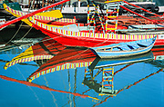 Beautifully hand-painted fishing boats along the Coimbra coast of Portugal.