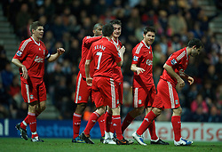 PRESTON, ENGLAND - Saturday, January 3, 2009: Liverpool's Albert Riera celebrates scoring the opening goal with team-mates against Preston North End during the FA Cup 3rd Round match at Deepdale. (Photo by David Rawcliffe/Propaganda)