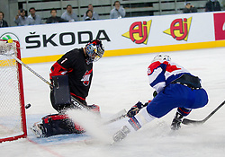 Masahito Haruna of Japan vs Ziga Jeglic of Slovenia during ice-hockey match between Slovenia and Japan at IIHF World Championship DIV. I Group A Slovenia 2012, on April 16, 2012 in Arena Stozice, Ljubljana, Slovenia. Slovenia defeated Japan 4-2. (Photo by Vid Ponikvar / Sportida.com)