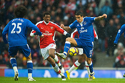 LONDON, ENGLAND - Saturday, January 9, 2010: Everton's Tim Cahill and Arsenal's Abou Diaby during the Premiership match at the Emirates Stadium. (Photo by David Rawcliffe/Propaganda)