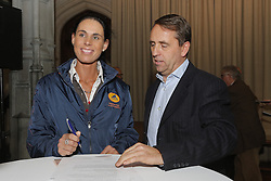 "Michele Georg and Peter Bollen signing a sponsor contract with Cavalor<br /> Pressconference ""Vlaanderens Kerstjumping"" - Mechelen 2012<br /> © Dirk Caremans"