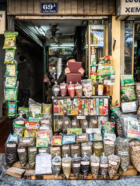 Shop filled with packets of traditional medicinal herbs along Lan Ong 'traditional medicine street' in Hanoi's Old Quarter, Vietnam, Southeast Asia