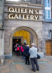 Tourists queue to enter the Queen's Gallery at Holyroodhouse in Edinburgh, Scotland.