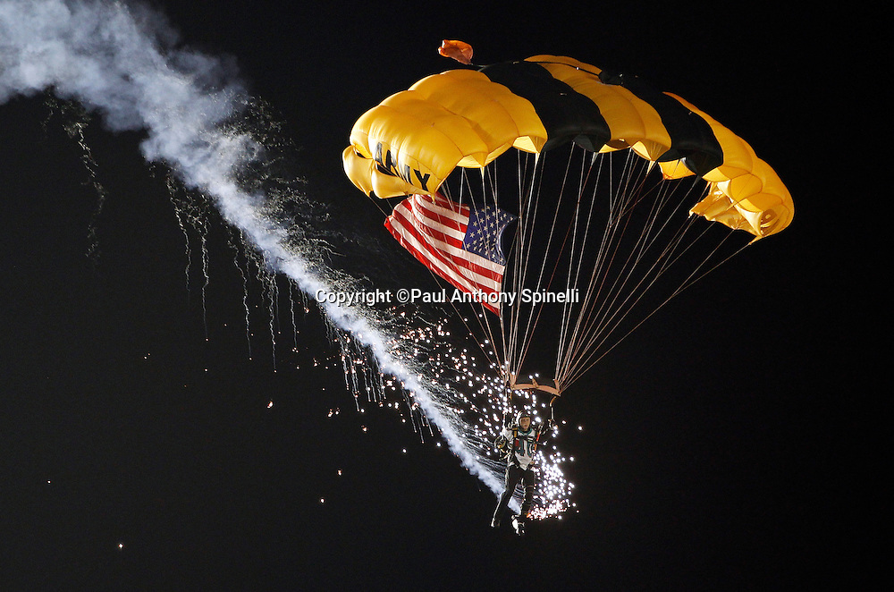 A member of the U.S. Army parachute team the Golden Knights parachutes into the stadium during the Miami Dolphins NFL week 1 football game against the New England Patriots on Monday, September 12, 2011 in Miami Gardens, Florida. The Patriots won the game 38-24. ©Paul Anthony Spinelli