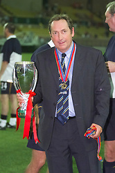 MONACO, FRANCE - Friday, August 24, 2001: Liverpool's manager Gerard Houllier with the UEFA Super Cup trophy after beating Bayern Munich 3-2 at the Stade Louis II in Monaco. (Pic by David Rawcliffe/Propaganda)