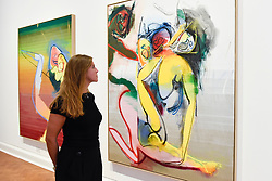 """© Licensed to London News Pictures. 04/09/2018. LONDON, UK. A staff member views (L to R) """"Umor"""", """"Leave"""" and """"Dean"""", all 2018, at a preview of an exhibition called """"I Should Have Known Better"""" by German artist Daniel Richter at Galerie Thaddaeus Ropac in Mayfair.  The exhibition runs 5 to 28 September 2018.  Photo credit: Stephen Chung/LNP"""