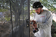 Affordable Fence & Gates crew installs my front security door.