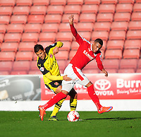 Fleetwood Town's Antoni Sarcevic vies for possession with Barnsley's Reece Wabara<br /> <br /> Photographer Chris Vaughan/CameraSport<br /> <br /> Football - The Football League Sky Bet League One - Barnsley v Fleetwood Town - Saturday 24th October 2015 - Oakwell Stadium - Barnsley<br /> <br /> © CameraSport - 43 Linden Ave. Countesthorpe. Leicester. England. LE8 5PG - Tel: +44 (0) 116 277 4147 - admin@camerasport.com - www.camerasport.com