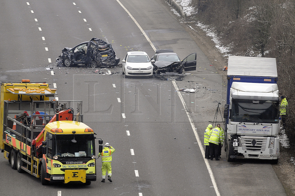 © Licensed to London News Pictures. 13/02/2013.A MAN has been arrested following a four-vehicle crash on the M25 near Orpington..Kent Police were called to the collision on the clockwise carriageway between Junction 4 for Orpington and Junction 5 for the A21 and M26 at about 10.15am..The serious collision involving a lorry and three cars means that section of motorway is likely to remain closed until about 5pm though the anti-clockwise carriageway has reopened..The air ambulance and two fire engines were also called to the scene and a woman was flown to a London hospital with injuries described as serious.Photo credit : Grant Falvey/LNP