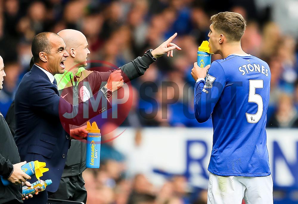 Everton Manager, Roberto Martinez shouts instructions to John Stones during a break in play  - Mandatory byline: Matt McNulty/JMP - 07966386802 - 12/09/2015 - FOOTBALL - Goodison Park -Everton,England - Everton v Chelsea - Barclays Premier League