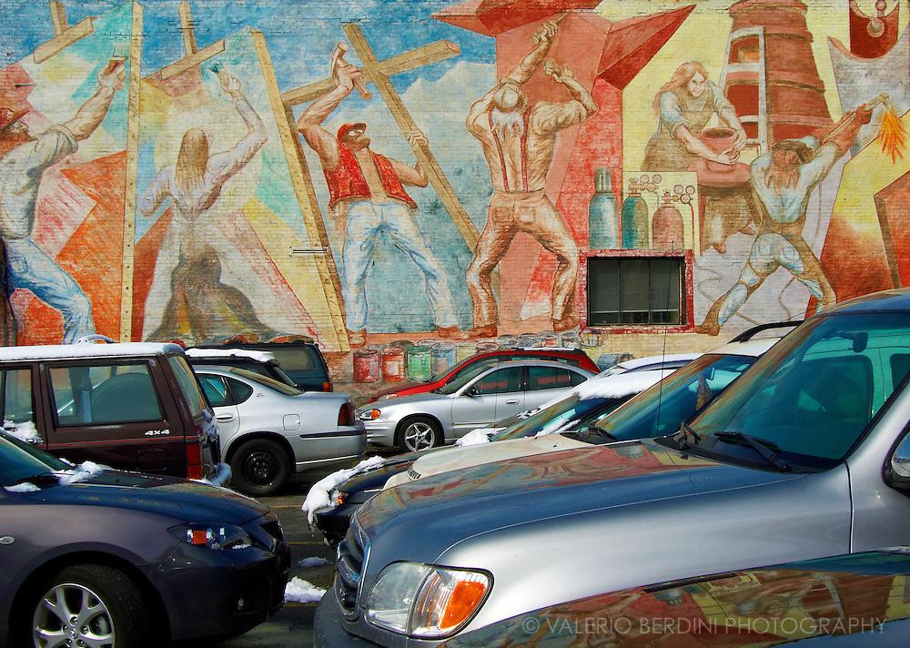 A car park and a graffiti wall.