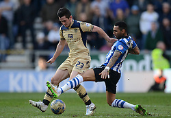 Leeds United's Lewis Cook competes with Wigan Athletic's Jermaine Pennant - Photo mandatory by-line: Richard Martin-Roberts/JMP - Mobile: 07966 386802 - 07/03/2015 - SPORT - Football - Wigan - DW Stadium - Wigan Athletic v Leeds United - Sky Bet Championship