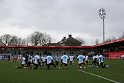 Crawley players warming up during the EFL Sky Bet League 2 match between Salford City and Crawley Town at the Peninsula Stadium, Salford, United Kingdom on 8 February 2020.