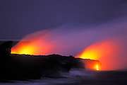 Lava flow entering the Pacific Ocean at dusk, Hawaii Volcanoes National Park, The Big Island, Hawaii