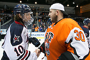 Robert Morris defenseman Tyson Wilson shakes hands with RIT goaltender Mike Rotolo after RIT defeated Robert Morris in the Atlantic Hockey final at the Blue Cross Arena in Rochester on Saturday, March 19, 2016.