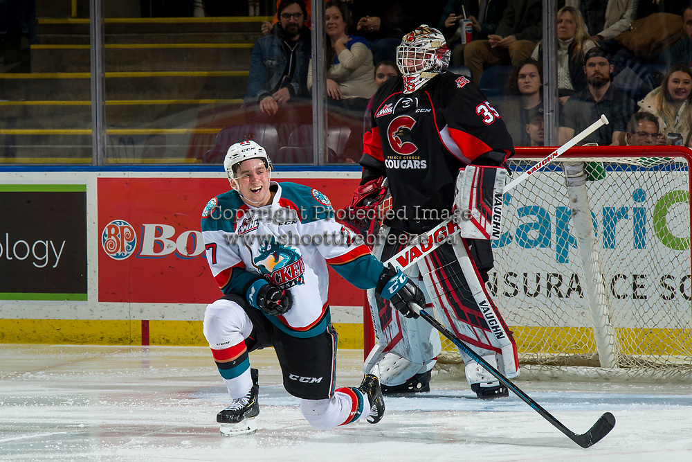 KELOWNA, CANADA - JANUARY 4: Taylor Gauthier #35 of the Prince George Cougars stands in net and laughs with Lane Zablocki #27 of the Kelowna Rockets after a shot hit the post and split the puck in half on January 4, 2019 at Prospera Place in Kelowna, British Columbia, Canada.  (Photo by Marissa Baecker/Shoot the Breeze)
