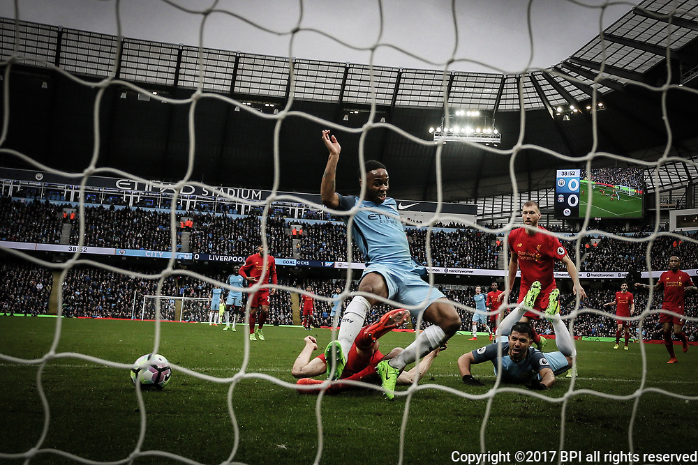 James Milner of Liverpool fouls Raheem Sterling of Manchester City but no penalty given during the Premier League match between Manchester City and Liverpool played at the Etihad Stadium, Manchester on 19th March 2017