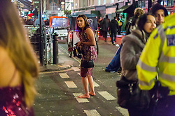 London, January 01 2018. A barefoot woman on Old Compton Street as revellers in London's West End enjoy New Year's Eve. © SWNS