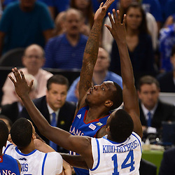 Apr 2, 2012; New Orleans, LA, USA; Kansas Jayhawks guard Tyshawn Taylor (blue) goes up for a shot as Kentucky Wildcats forward Michael Kidd-Gilchrist (14) defends during the first half in the finals of the 2012 NCAA men's basketball Final Four at the Mercedes-Benz Superdome. Mandatory Credit: Derick E. Hingle-US PRESSWIRE