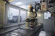 A Magneto-Rheological Finishing (MRF) machine, used to finish high quality optics, at Exelis Inc. in Rochester, New York on September 10, 2014. Exelis is an aerospace and defense company, and employs numerous former Kodak workers in its Rochester facility.