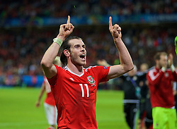 LILLE, FRANCE - Friday, July 1, 2016: Wales' Gareth Bale celebrates a 3-1 victory over Belgium and reaching the Semi-Final during the UEFA Euro 2016 Championship Quarter-Final match at the Stade Pierre Mauroy. (Pic by David Rawcliffe/Propaganda)