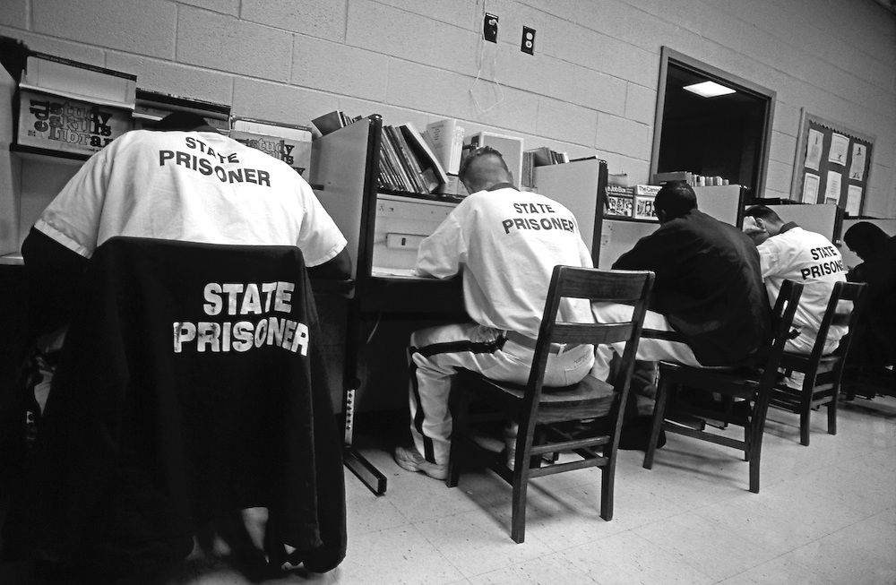 State Prisoners study English textbooks at a correctional facility in Georgia.