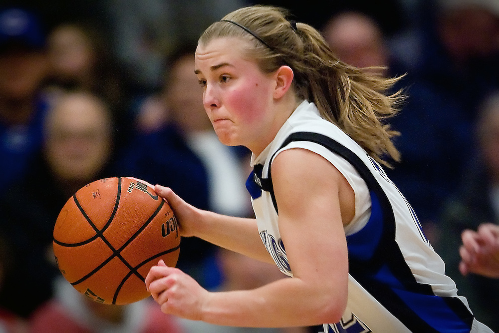 JEROME A. POLLOS/Press..Coeur d'Alene High's Amy Warbrick speeds down the court past the Post Falls defense during the 5A Region 1 championship game Friday.