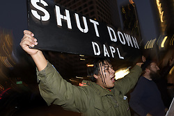 December 3, 2016 - Los Angeles, California, United States - Native American activist, Michael Westbrook Jr., holds a sign during a protest against the Dakota Access Pipeline on December 3, 2016 in Los Angeles, California. Protesters gathered in solidarity with the Sioux tribe in their efforts to stop the construction of the oil pipeline. (Credit Image: © Ronen Tivony/NurPhoto via ZUMA Press)