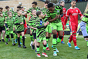 Mascot with Forest Green Rovers Ebou Adams(14) during the EFL Sky Bet League 2 match between Forest Green Rovers and Scunthorpe United at the New Lawn, Forest Green, United Kingdom on 7 December 2019.