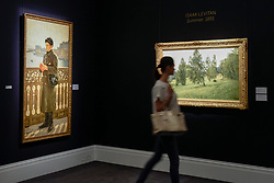 """© Licensed to London News Pictures. 02/06/2017. London, UK. A visitor walks by (L to R) """"Portrait of Yuri Repin by the Bay of Naples"""", 1894, by Ilya Repin (Est. GBP 0.7-1m) and """"Summer"""", 1891, by Isaak Levitan (est. 1-1.5m).  Preview of Sotheby's sale of Russian pictures and works of art which takes place on 6 June 2017 at Sotheby's in New Bond Street. Photo credit : Stephen Chung/LNP"""
