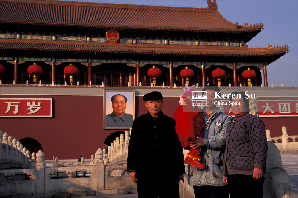 Three generation family take picture with Tian An Men Tower Beijing China