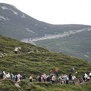 Pilgrims climb Mountain Croagh Patrick during Reek Sunday.