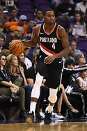 Oct 11, 2017; Phoenix, AZ, USA; Portland Trail Blazers forward Maurice Harkless (4) dribbles the ball up the court against the Phoenix Suns in the first half at Talking Stick Resort Arena. Mandatory Credit: Jennifer Stewart-USA TODAY Sports
