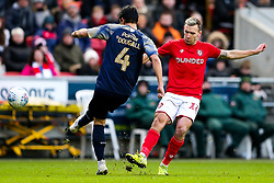 Andi Weimann of Bristol City is challenged by Kenny Dougall of Barnsley - Rogan/JMP - 18/01/2020 - Ashton Gate Stadium - Bristol, England - Bristol City v Barnsley - Sky Bet Championship.