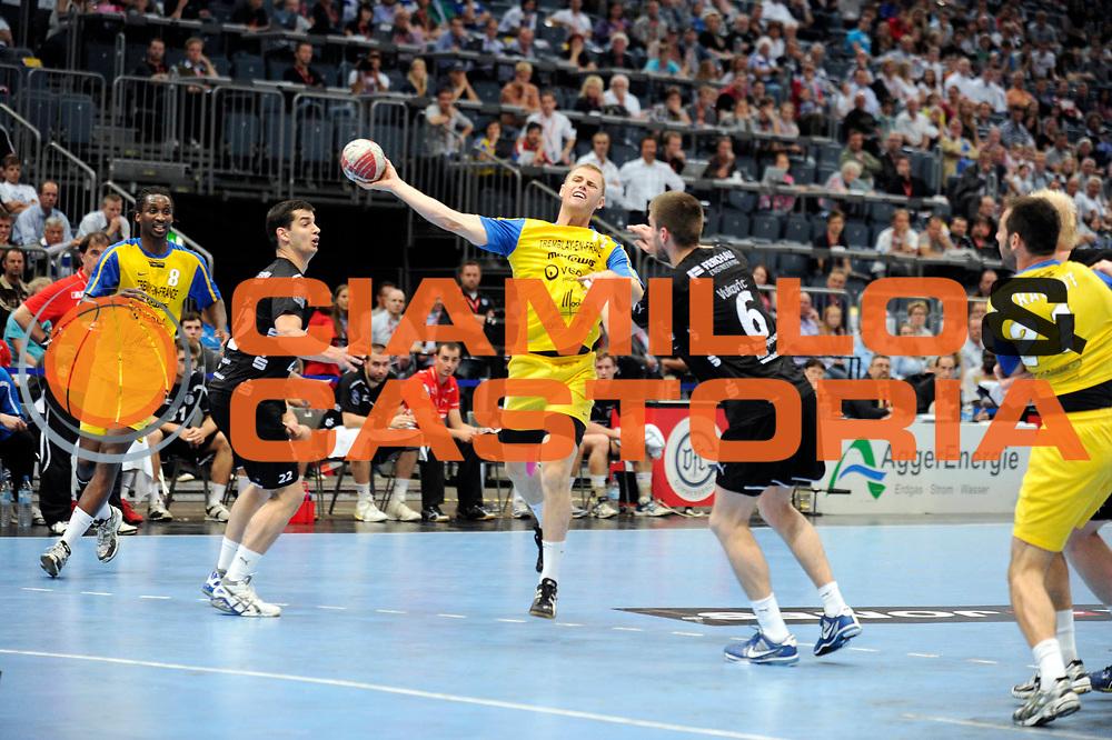 DESCRIZIONE : Handball coupe des coupes finale Tremblay Gummersbach<br /> GIOCATORE : Mongin Sebastien<br /> SQUADRA : Tremblay <br /> EVENTO : Coupe d'europe 2010-2011<br /> GARA : Tremblay Gummersbach<br /> DATA : 20/05/2011<br /> CATEGORIA : Handball Coupe d'europe<br /> SPORT : Handball<br /> AUTORE : JF Molliere par Agenzia Ciamillo-Castoria <br /> Galleria : France Hand 2010-2011 Action<br /> Fotonotizia : coupe des coupe finale Tremblay Gummersbach<br />   Match retour a Gummersbach