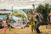Kids play with bubbles at Pickathon 2013 at Pendarvis Farm just outside of Portland, OR on Aug 2, 2013. Photo Credit: Mick Orlosky