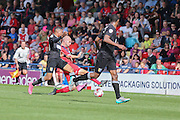 York captain York City midfielder Russell Penn is tackled and subsequently leads to Mnsfield taking the lead 2-1  during the Sky Bet League 2 match between York City and Mansfield Town at Bootham Crescent, York, England on 29 August 2015. Photo by Simon Davies.