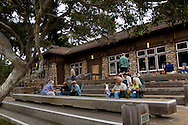Guests relaxing outside the main lodge at Asilomar Conference Center, Pacific Grove, Monterey Peninsula, California