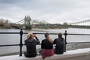 Hammersmith. London. United Kingdom,  Spectators  watching the 2018 Men's Head of the River Race.  Championship Course, Putney to Mortlake. River Thames, <br /> <br /> Sunday   11/03/2018<br /> <br /> [Mandatory Credit:Peter SPURRIER Intersport Images]<br /> <br /> LEICA CAMERA AG  LEICA Q (Typ 116)  1/1000 sec. 28 mm f.2.8 200 ISO.  42.3MB