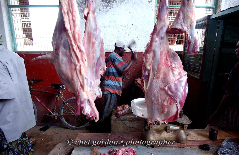 Kenyan butcher chops goat meat inside the meat market in Lamu, Kenya on Saturday morning, May 13, 2006.