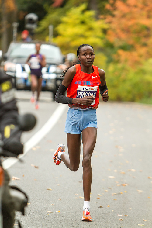 ING New York CIty Marathon: Priscah Jeptoo breaks from Buzunesh Deba near mile 25 en route to victory