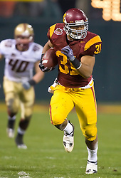 Dec 26, 2009; San Francisco, CA, USA;  Southern California Trojans fullback Stanley Havili (31) rushes past Boston College Eagles linebacker Luke Kuechly (40) during the first quarter in the 2009 Emerald Bowl at AT&T Park.  USC defeated BC 24-13.