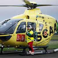 SCAA (Scotlands Charity Air Ambulance) EC135 T2i helicopter, callsign Helimed 76 at Perth..Picture shows the Paramedics leaving the helicopter after returning from a job<br /> Picture by Graeme Hart.<br /> Copyright Perthshire Picture Agency<br /> Tel: 01738 623350  Mobile: 07990 594431