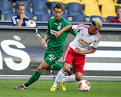 22.08.2013, Red Bull Arena, Salzburg, AUT, UEFA EL Play Off, FC Red Bull Salzburg vs VMFD Zalgiris, Hinspiel, im Bild Vaidotas Silenas, (VMFD Zalgiris Vilnius, #20) und Kevin Kampl, (FC Red Bull Salzburg, #44)// during UEFA Europa League Qualification 1st Leg Match between FC Red Bull Salzburg and VMFD Zalgiris at the Red Bull Arena, Salzburg, Austria on 2013/08/22. EXPA Pictures © 2013, PhotoCredit: EXPA/ Roland Hackl